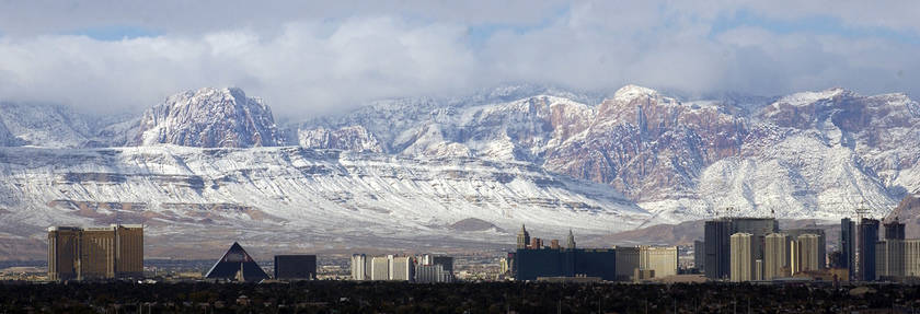 The Las Vegas Strip is seen with the snow-covered Spring Mountains on Dec. 16, 2008. (Las Vegas Review-Journal)