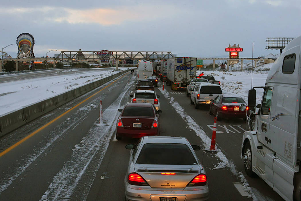 Vehicles line southbound Interstate 15 at Primm after the freeway was closed on Dec. 18, 2008, due to a snowstorm that blew through southern Nevada and parts of California. (Las Vegas Review-Journal)