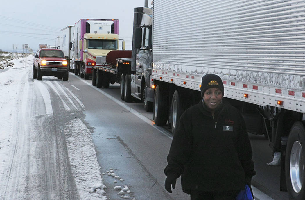 Cora Anderson, a food server at Whiskey Pete's casino, walks a half mile to work after Interstate 15 into California was closed at Primm on Dec. 18, 2008. The freeway became a parking lot as casi ...