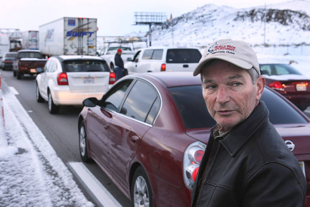 Bob Hazel of Orlando, Florida, waits to get to his room at Buffalo Bill's after Interstate 15 into California was closed at Primm on Dec. 18, 2008. The freeway became a parking lot as casino parki ...