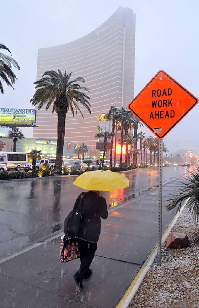 A woman braves the elements as she walks down the Las Vegas Strip near the Encore on Dec. 17, 2008. (Las Vegas Review-Journal)