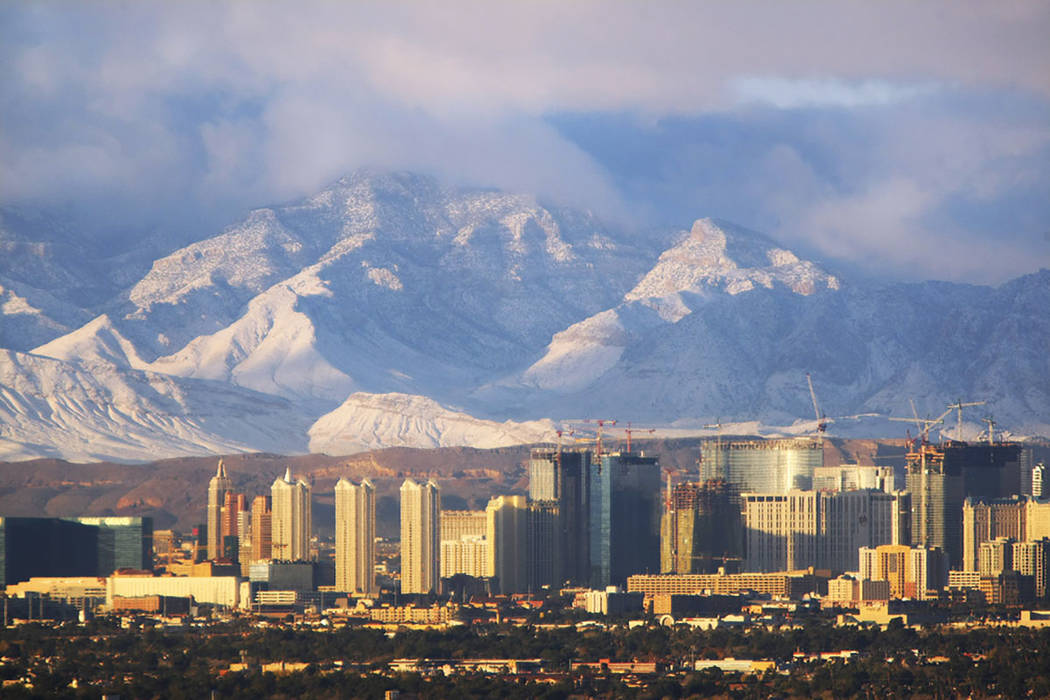The morning sunlight gives a glow to the Las Vegas Strip and the snow-dusted Spring Mountains on Tuesday, Dec. 16, 2008. (Las Vegas Review-Journal)