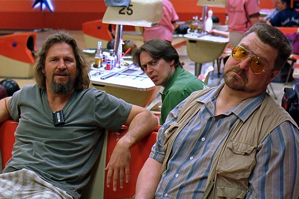 """Jeff Bridges as """"The Dude"""" hangs out at the bowling alley with his buddies Walter (John Goodman) and Donny (Steve Buscemi). (Courtesy Universal Studios)"""