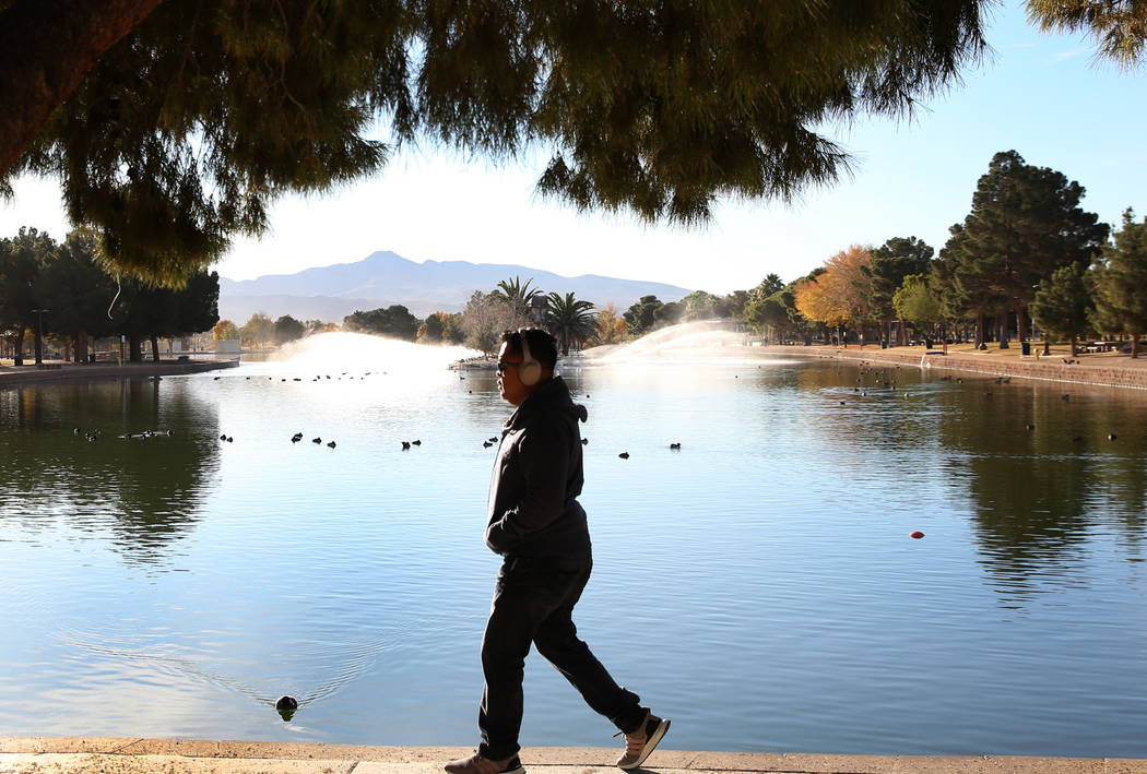 Robert Julian of Las Vegas listens to music while walking at Sunset Park in Las Vegas. (Bizuayehu Tesfaye/Las Vegas Review-Journal) @bizutesfaye