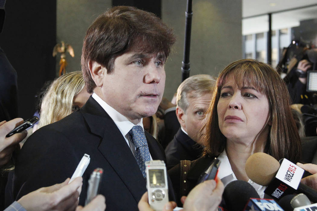 In this Dec. 7, 2011 file photo, former Illinois Gov. Rod Blagojevich, left, speaks to reporters as his wife, Patti, listens at the federal building in Chicago. President Donald Trump says he is c ...