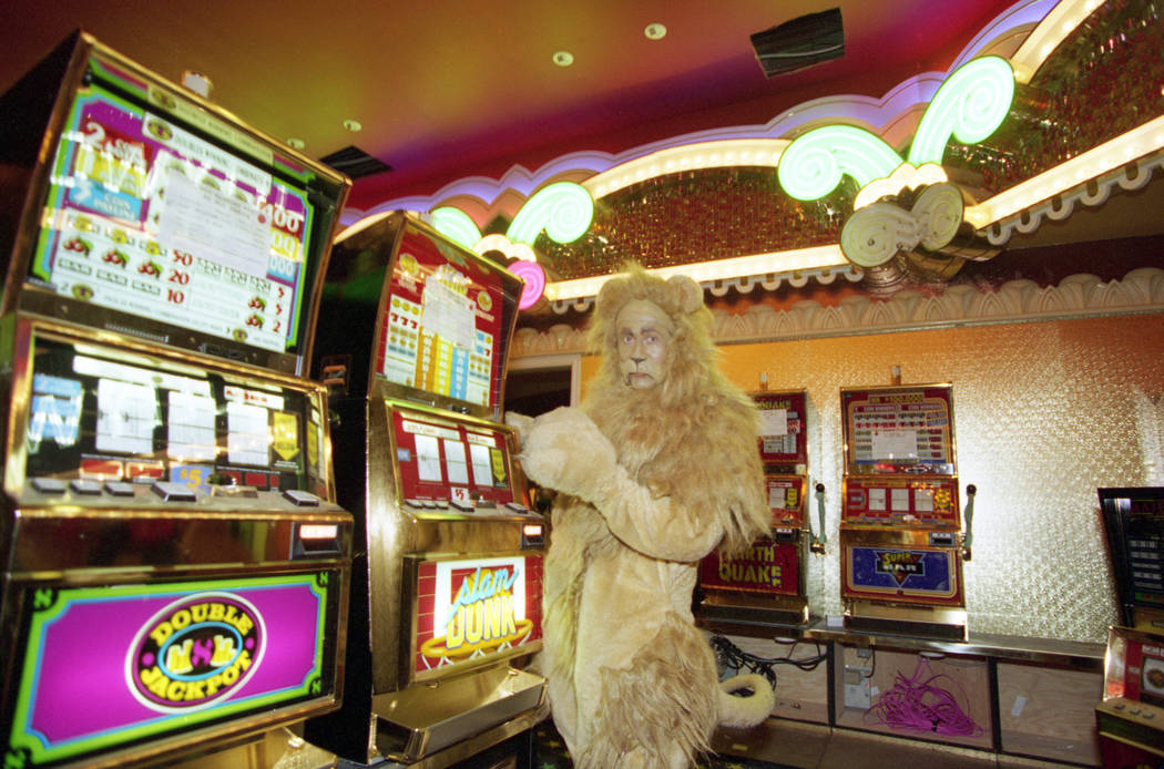 "The Cowardly Lion from the movie ""The Wizard of Oz"" plays the slot machines during a pre opening tour of the MGM Grand in November 1993. MGM Grand was the world's first combined hotel, c ..."