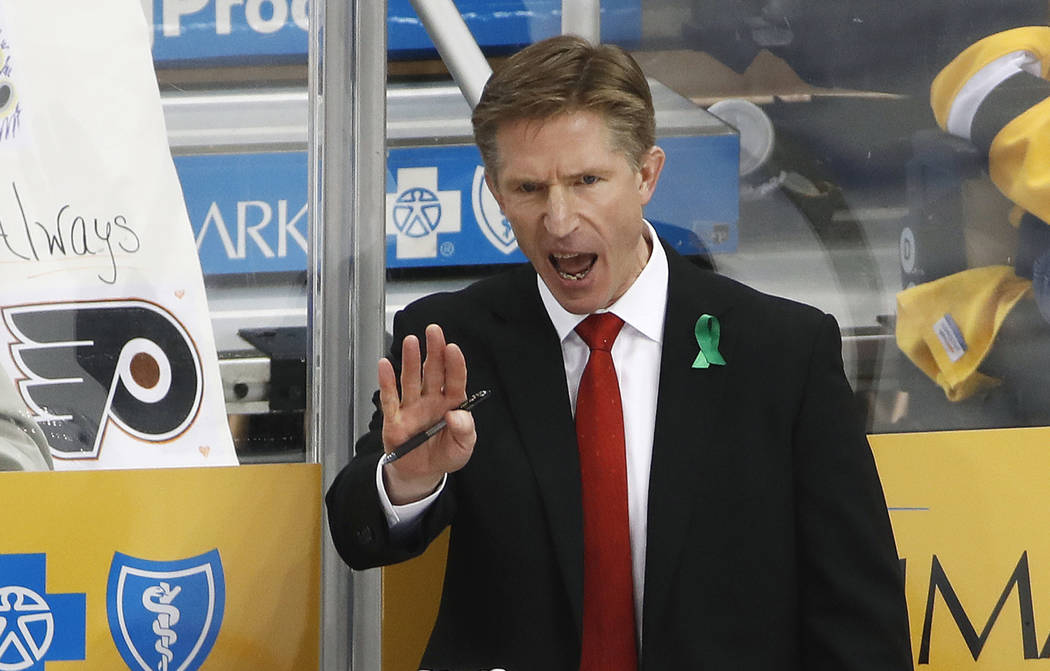 In this April 13, 2018, file photo, Philadelphia Flyers head coach Dave Hakstol gives instructions during the third period in Game 2 of an NHL first-round hockey playoff series against the Pittsbu ...