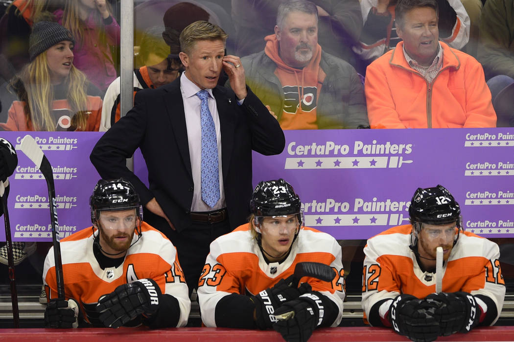 In this Nov. 27, 2018, file photo, Philadelphia Flyers head coach Dave Hakstol watches from the bench during an NHL hockey game against the Ottawa Senators, in Philadelphia. (AP Photo/Derik Hamilt ...