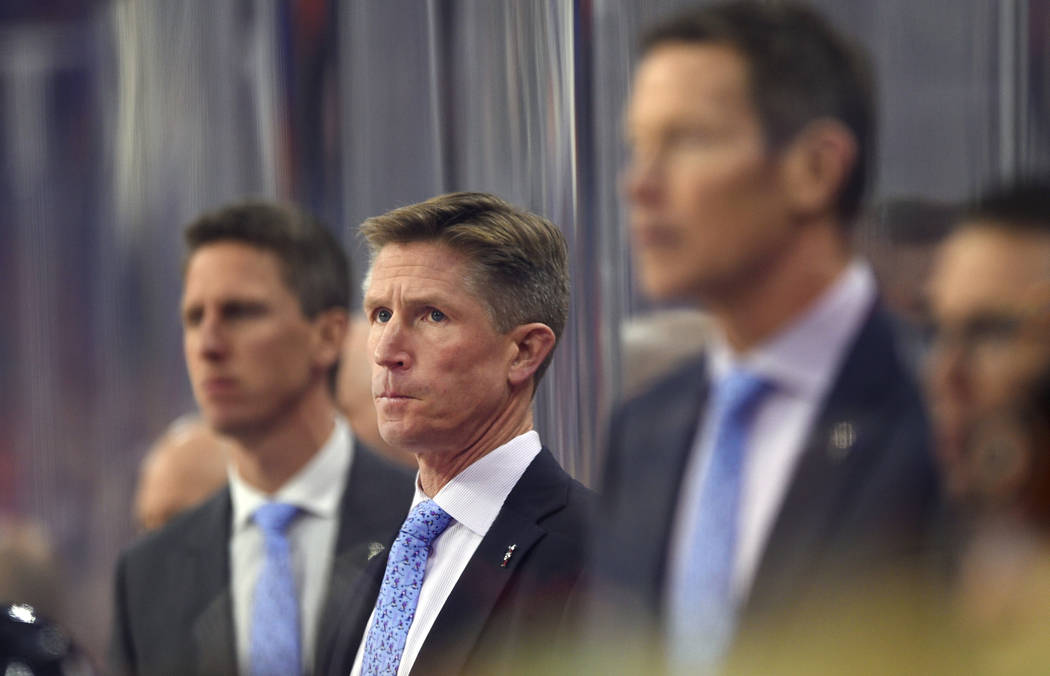 In this Tuesday, Nov. 27, 2018, file photo, Philadelphia Flyers head coach Dave Hakstol, center, watches during an NHL hockey game against the Ottawa Senators in Philadelphia. (AP Photo/Derik Hami ...