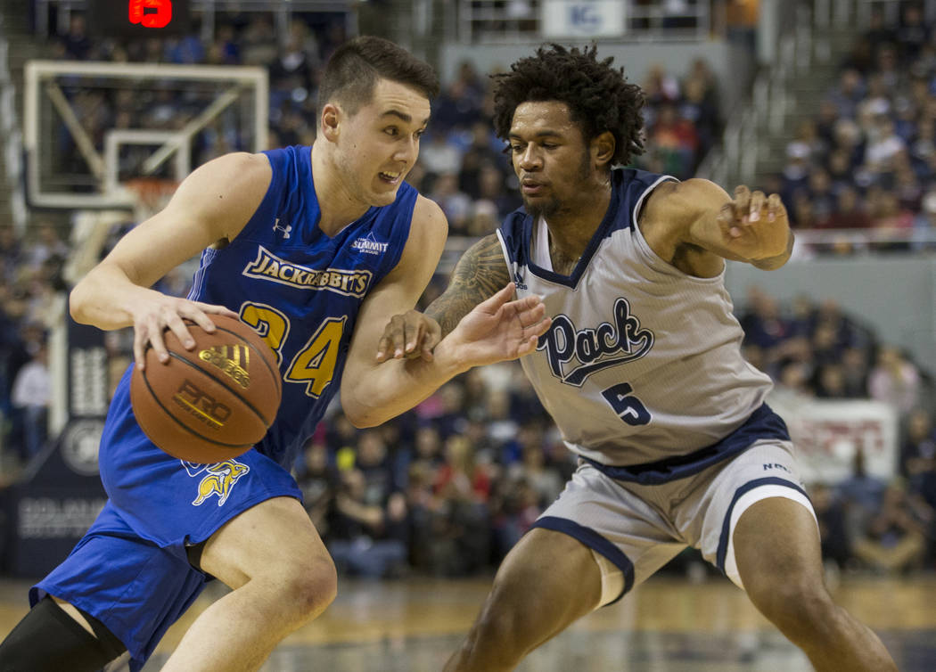 South Dakota State guard Alex Arians (34) drives against Nevada's Nisre Zouzoua (5) in the second half of an NCAA college basketball game in Reno, Nev., Saturday, Dec. 15, 2018. (AP Photo/Tom R. S ...