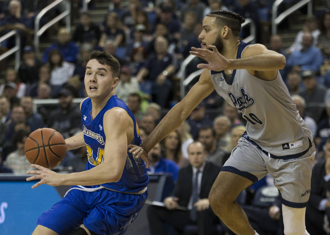 South Dakota State guard Alex Arians (34) drives against Nevada's Caleb Martin (10) in the second half of an NCAA college basketball game in Reno, Nev., Saturday, Dec. 15, 2018. (AP Photo/Tom R. S ...