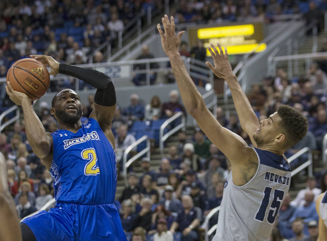 South Dakota State guard Tevin King (2) shoots over Nevada's Trey Porter (15) in the second half of an NCAA college basketball game in Reno, Nev., Saturday, Dec. 15, 2018. (AP Photo/Tom R. Smedes)