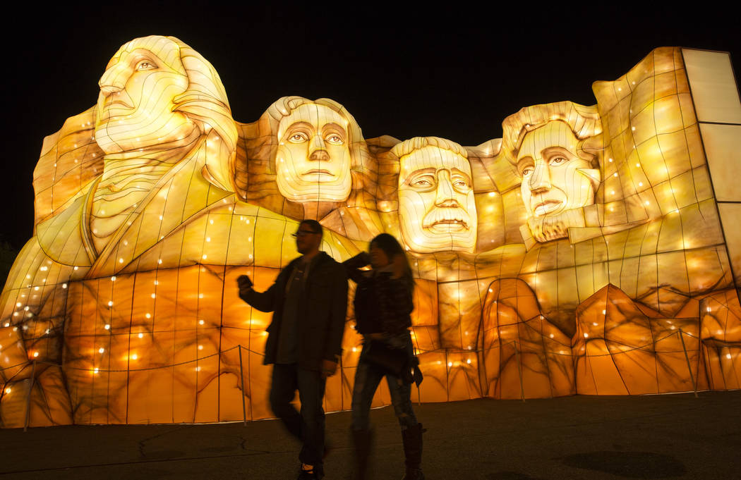 A couple walk past the Mount Rushmore National Memorial display at the Global Winter Wonderland lantern festival at the Rio in Las Vegas on Wednesday, Dec. 19, 2018. Richard Brian Las Vegas Review ...