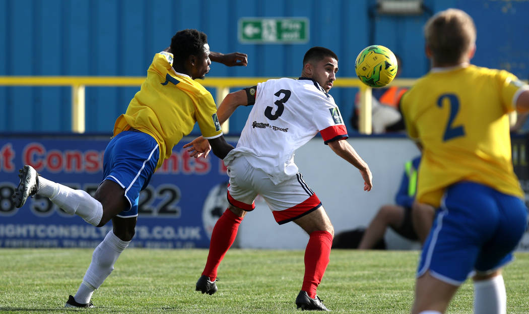 Canvey Island midfielder Josh Hutchinson (7) chases Cray Wanderers full back Barney Williams (3) as he heads the soccer ball towards Jake Pitty (2) in Canvey Island, Essex, England, Saturday, Oct. ...