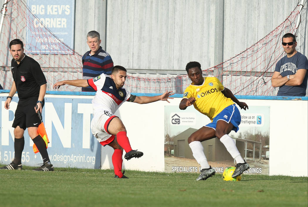 Cray Wanderers full back Barney Williams' (3) kick is intercepted by Canvey Island Gulls midfielder Josh Hutchinson (7) during a game in Canvey Island, Essex, England, Saturday, Oct. 13, 2018. Hei ...