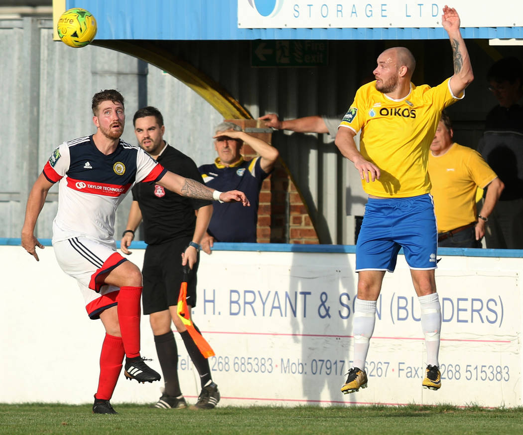 Canvey Island Gulls striker Martin Tuohy (9), right, heads the soccer ball away from Cray Wanderers midfielder Tom Phipp (5) during a game in Canvey Island, Essex, England, Saturday, Oct. 13, 2018 ...