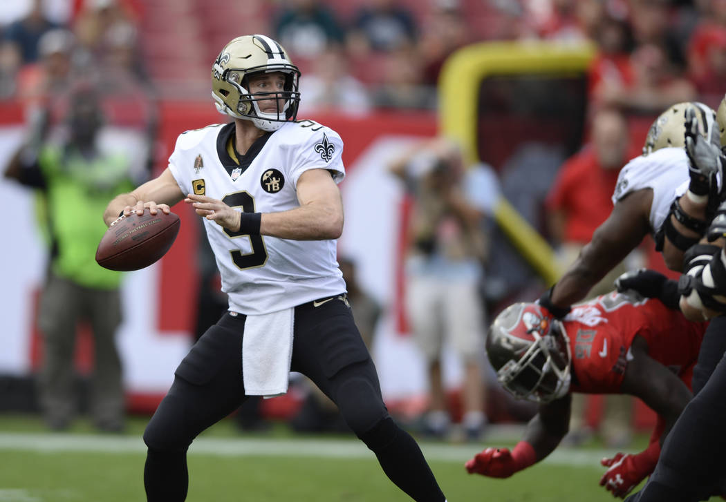 In this Sunday, Dec. 9, 2018 file photo, New Orleans Saints quarterback Drew Brees (9) throws a pass against the Tampa Bay Buccaneers during the first half of an NFL football game in Tampa, Fla. ( ...