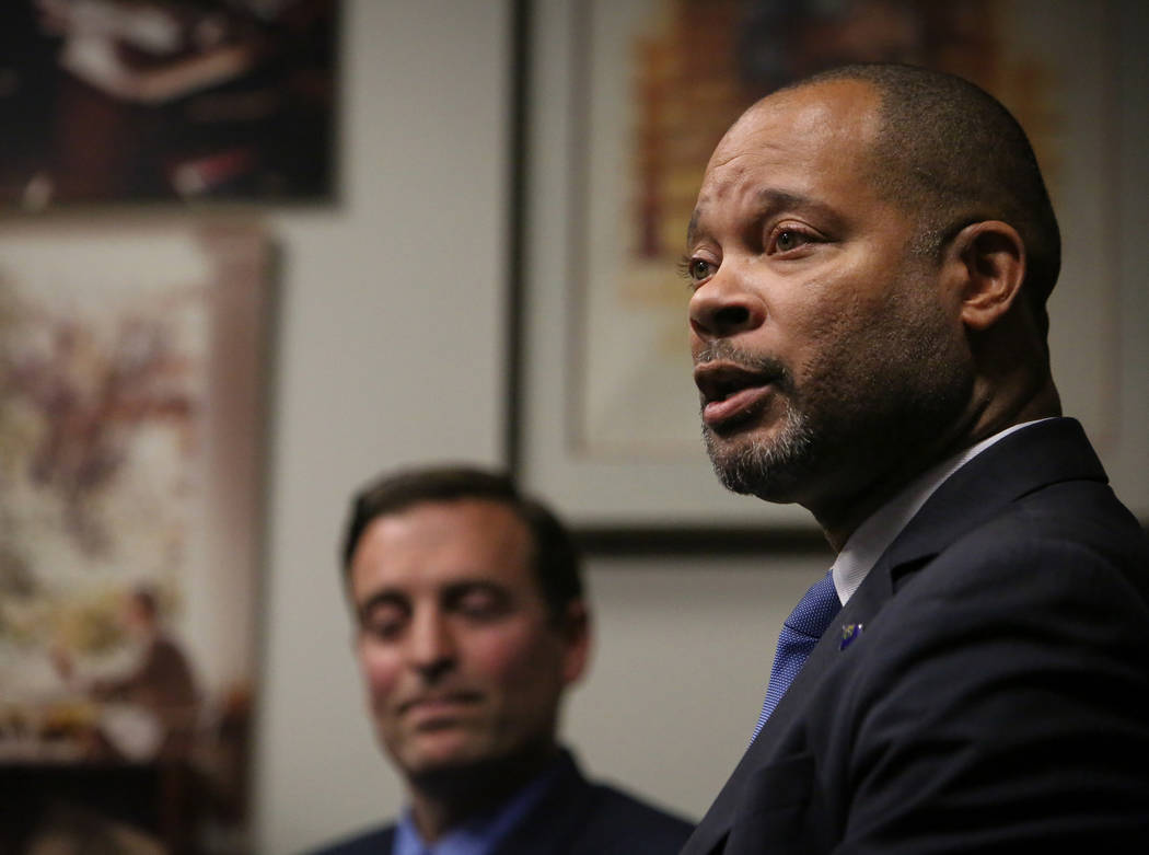 Nevada's incoming Democratic Attorney General Aaron Ford, right, speaks as outgoing Republican Attorney General Adam Laxalt listens during a press briefing in Las Vegas, Monday, Dec. 17, 2018. (Ca ...