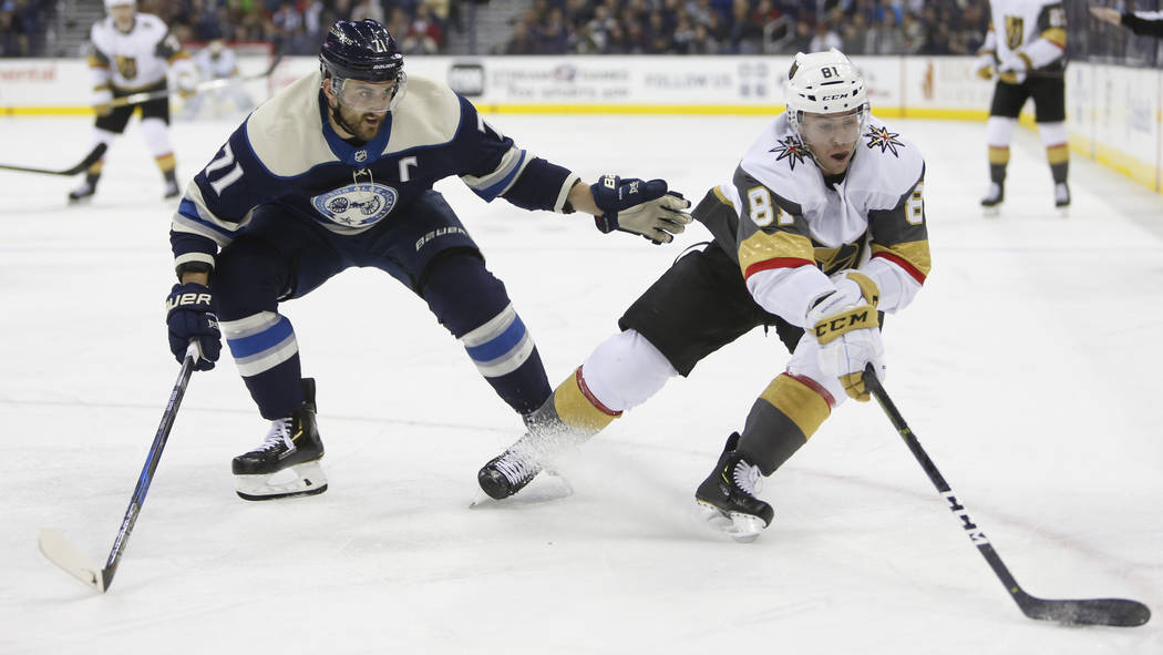 Vegas Golden Knights' Jonathan Marchessault, right, controls the puck as Columbus Blue Jackets' Nick Foligno defends during the third period of an NHL hockey game Monday, Dec. 17, 2018, in Columbu ...