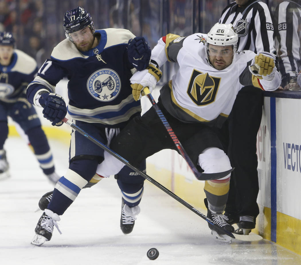 Columbus Blue Jackets' Brandon Dubinsky, left, and Vegas Golden Knights' Paul Stastny chase a loose puck during the first period of an NHL hockey game Monday, Dec. 17, 2018, in Columbus, Ohio. (AP ...