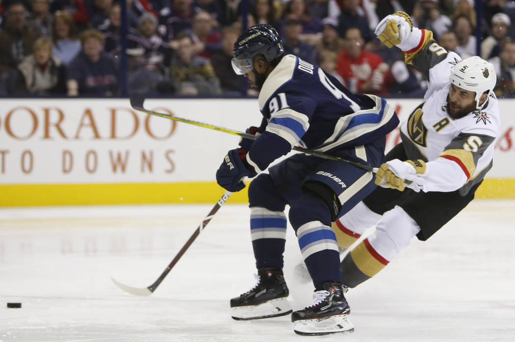 Columbus Blue Jackets' Anthony Duclair, left, and Vegas Golden Knights' Deryk Engelland collide during the second period of an NHL hockey game Monday, Dec. 17, 2018, in Columbus, Ohio. (AP Photo/J ...