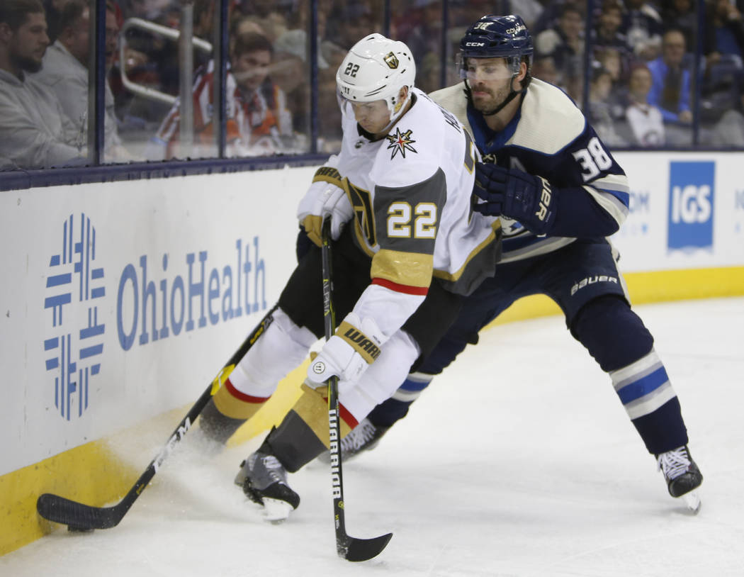 Columbus Blue Jackets' Boone Jenner, right, tries to knock the puck away from Vegas Golden Knights' Nick Holden during the second period of an NHL hockey game Monday, Dec. 17, 2018, in Columbus, O ...