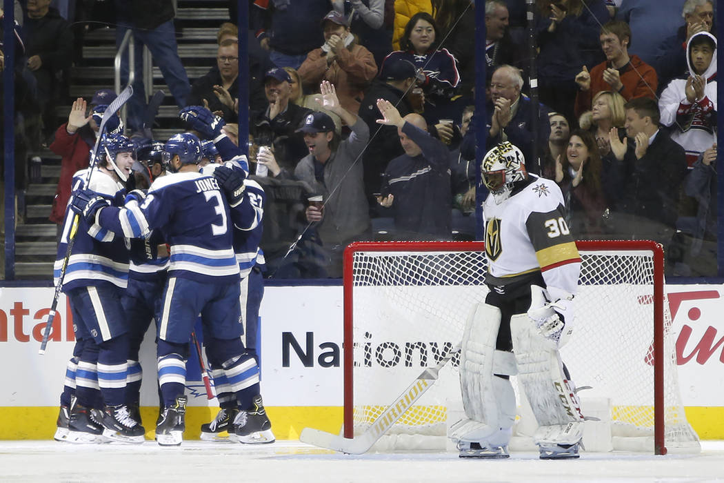 Columbus Blue Jackets players celebrate their goal against Vegas Golden Knights' Malcolm Subban during the third period of an NHL hockey game Monday, Dec. 17, 2018, in Columbus, Ohio. The Blue Jac ...