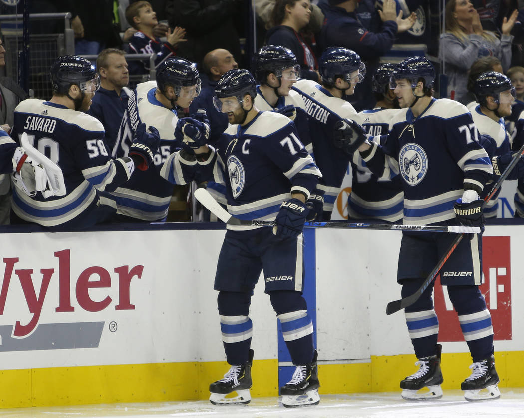 Columbus Blue Jackets' Nick Foligno, left, celebrates his winning goal against the Vegas Golden Knights with teammates during the third period of an NHL hockey game Monday, Dec. 17, 2018, in Colum ...
