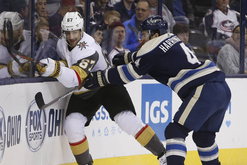 Columbus Blue Jackets' Scott Harrington, right, checks Vegas Golden Knights' Max Pacioretty during the first period of an NHL hockey game Monday, Dec. 17, 2018, in Columbus, Ohio. (AP Photo/Jay La ...
