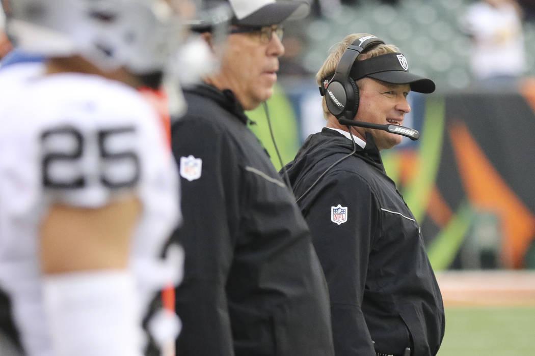 Oakland Raiders head coach Jon Gruden works the sidelines in the second half of an NFL football game against the Cincinnati Bengals, Sunday, Dec. 16, 2018, in Cincinnati. (AP Photo/Gary Landers)