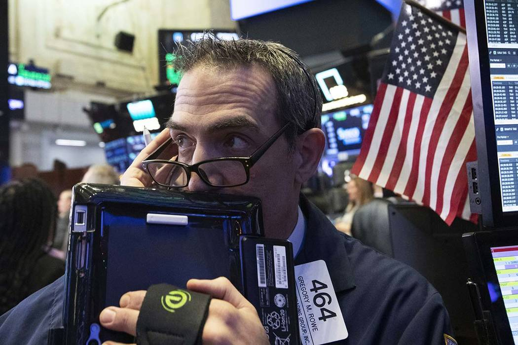 Trader Gregory Rowe works at the New York Stock Exchange, Wednesday, Dec. 12, 2018, in New York. (Mark Lennihan/AP, File)