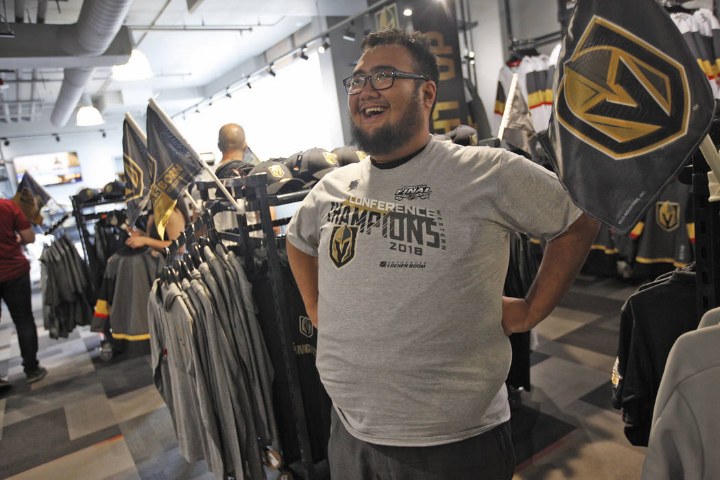 Faustino Solis tries on his Golden Knights western conference championship shirt at the Arsenal retail store at the City National Arena in Las Vegas, Sunday, May 20, 2018. The shirts, all 150 of t ...