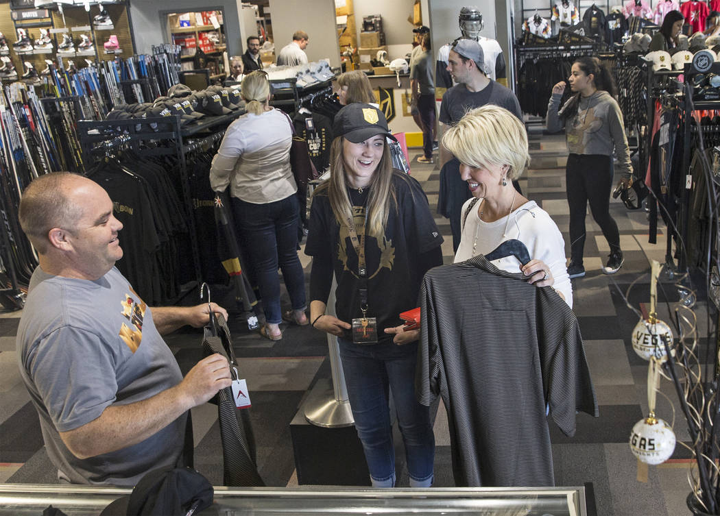 Brian Baker, left, Anna Sommers and Debbie Ikirt talk Golden Knights gear on Wednesday, April 18, 2018, at The Arsenal, in Las Vegas. Benjamin Hager Las Vegas Review-Journal @benjaminhphoto