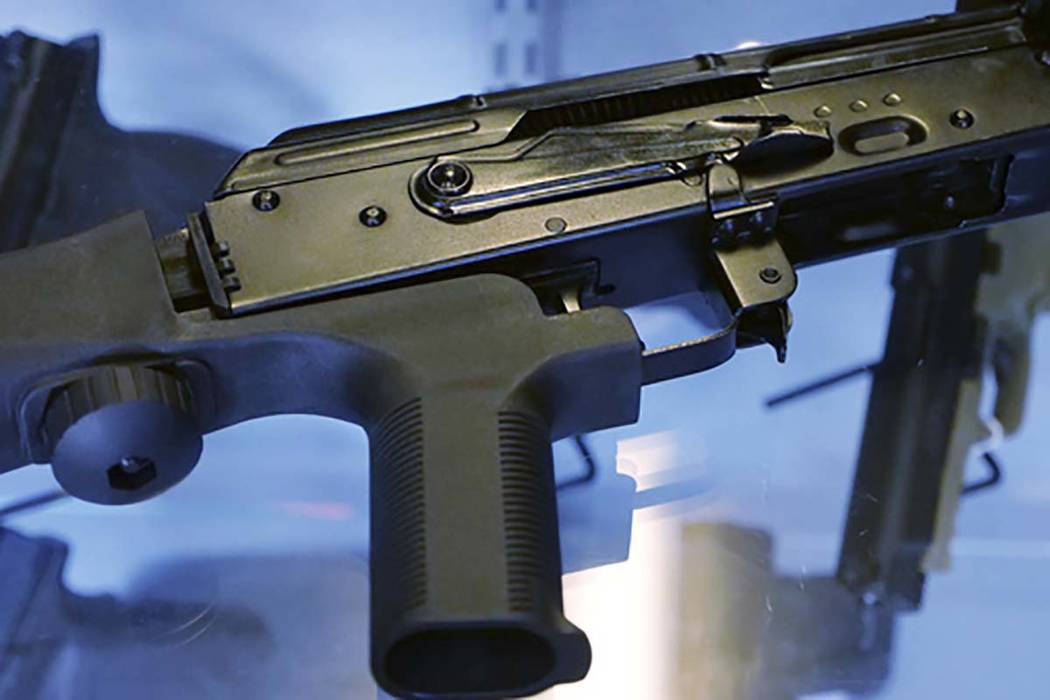 "This Oct. 4, 2017 file photo, shows a ""bump stock"" attached to a semi-automatic rifle at a gun store and shooting range in Utah. (Rick Bowmer/AP File)"