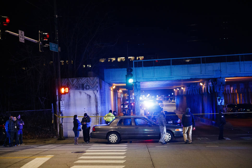 Police investigate the scene where two officers were killed after they were struck by a South Shore train near 103rd Street and Dauphin Avenue on Monday, Dec. 17, 2018, in Chicago. Police spokesma ...