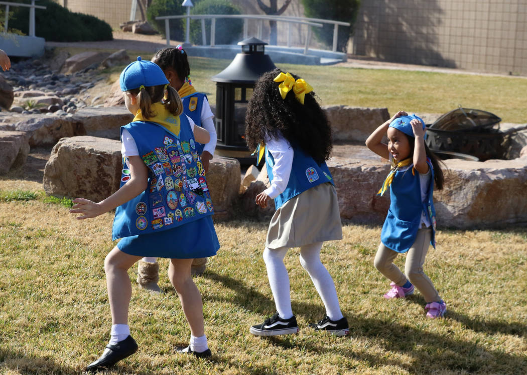 Girl Scouts, including Penelope Won, 5, right, play during a press conference on Tuesday, Dec, 18, 2018, in Las Vegas where John Mowbray, not photographed, trustee of the Charles and Phyllis M. Fr ...