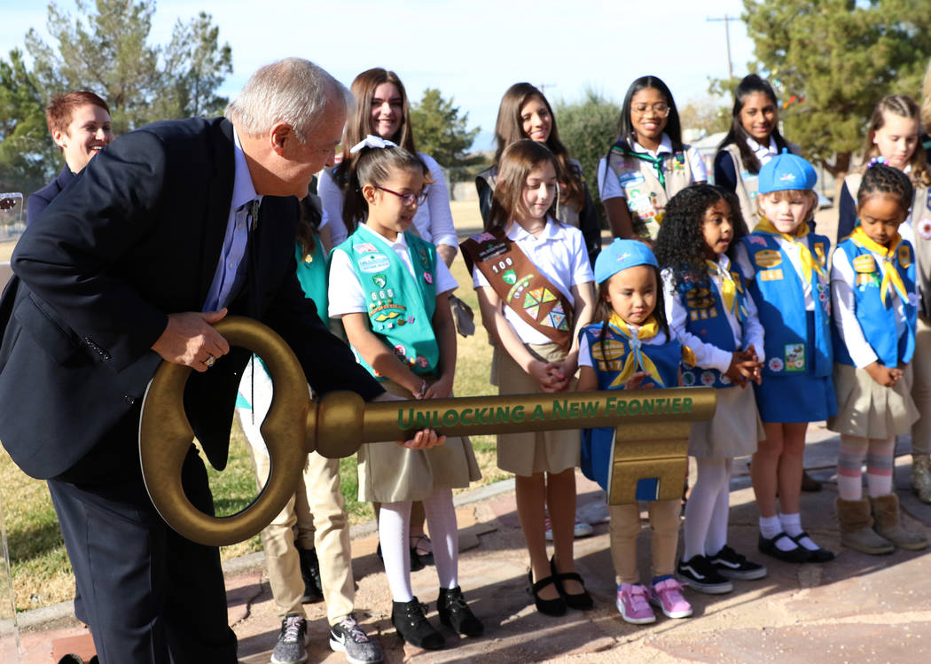 John Mowbray, trustee of the Charles and Phyllis M. Frias Charitable Trust, prepares to pose for a photo with Girl Scouts after a press conference on Tuesday, Dec, 18, 2018, in Las Vegas where he ...