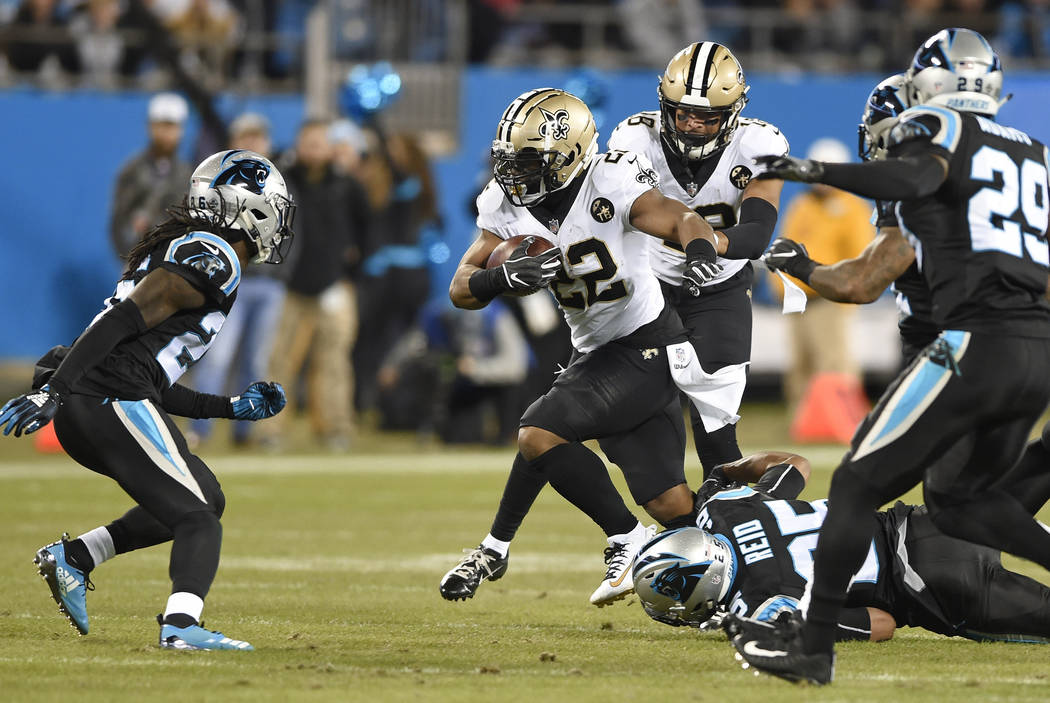 New Orleans Saints' Mark Ingram (22) runs against the Carolina Panthers in the first half of an NFL football game in Charlotte, N.C., Monday, Dec. 17, 2018. (AP Photo/Mike McCarn)