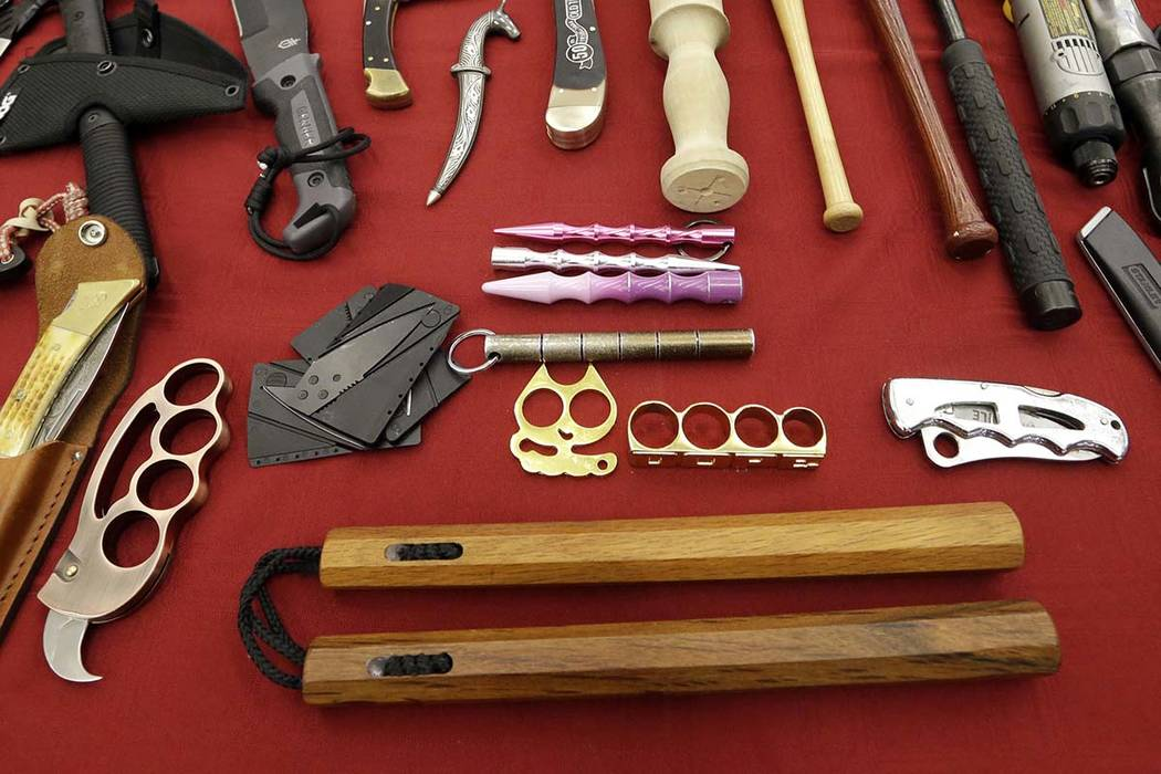 In this April 6, 2017, file photo, objects confiscated from passengers' carry-on luggage, including nunchucks, bottom, are displayed at Seattle-Tacoma International Airport in SeaTac, Wash. A fede ...