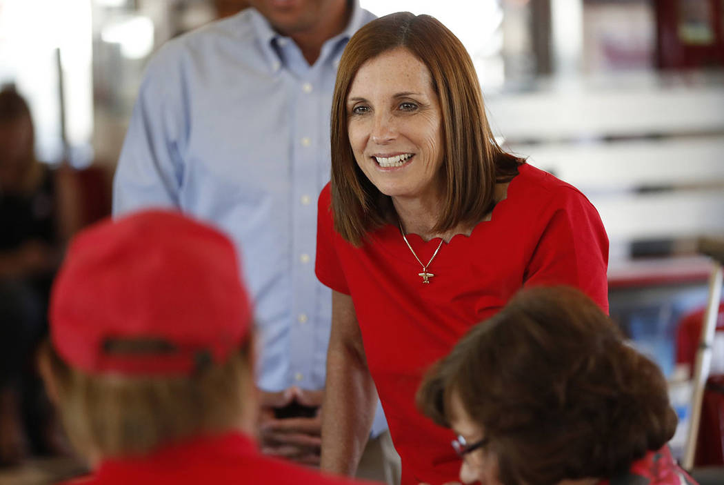 Arizona Republican senatorial candidate Martha McSally, speaks with voters, Tuesday, Nov. 6, 2018, at Chase's diner in Chandler, Ariz. McSally lost in November to Krysten Sinema, but on Tuesday wa ...