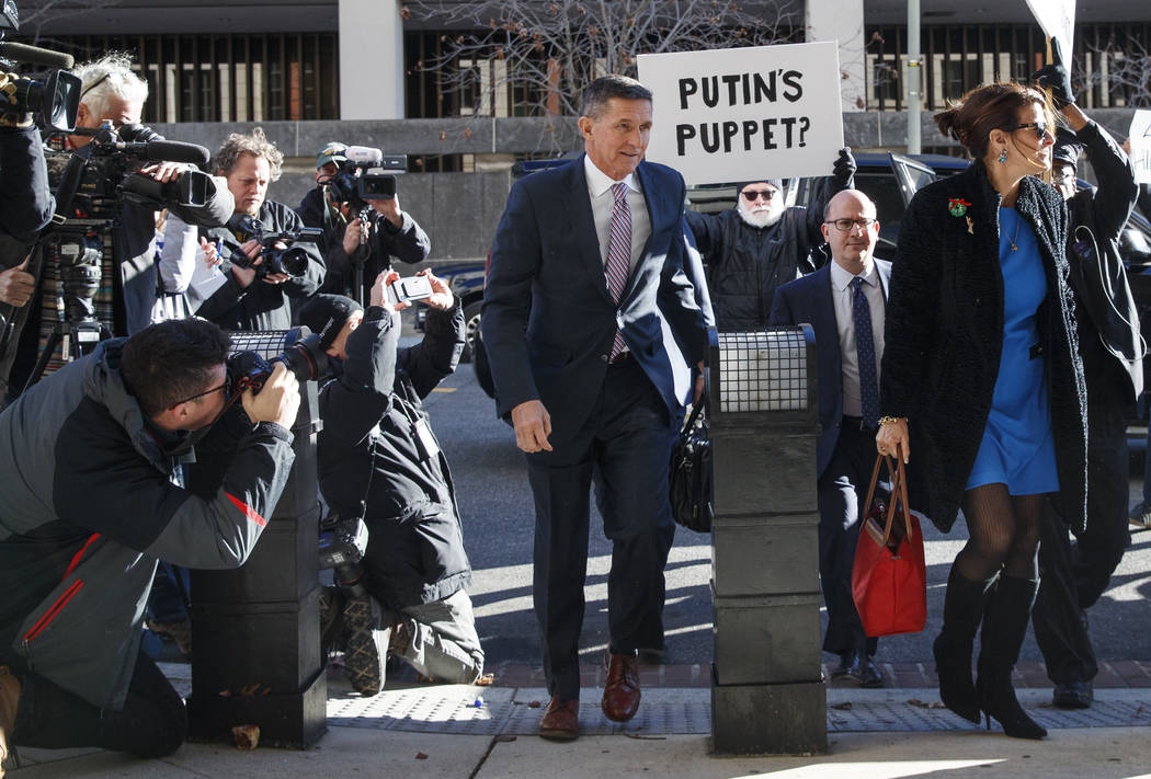 President Donald Trump's former National Security Advisor Michael Flynn and his wife Lori Andrade arrive at federal court in Washington, Tuesday, Dec. 18, 2018. (AP Photo/Carolyn Kaster)