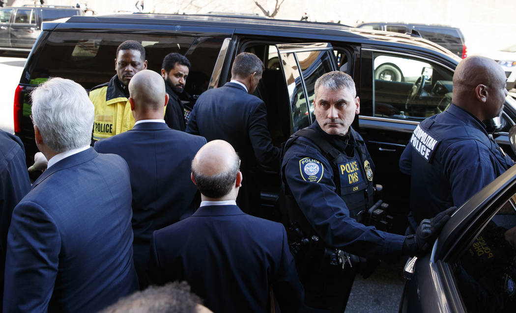 President Donald Trump's former national security adviser Michael Flynn enters his vehicle as he leaves federal court in Washington, Tuesday, Dec. 18, 2018. (AP Photo/Carolyn Kaster)