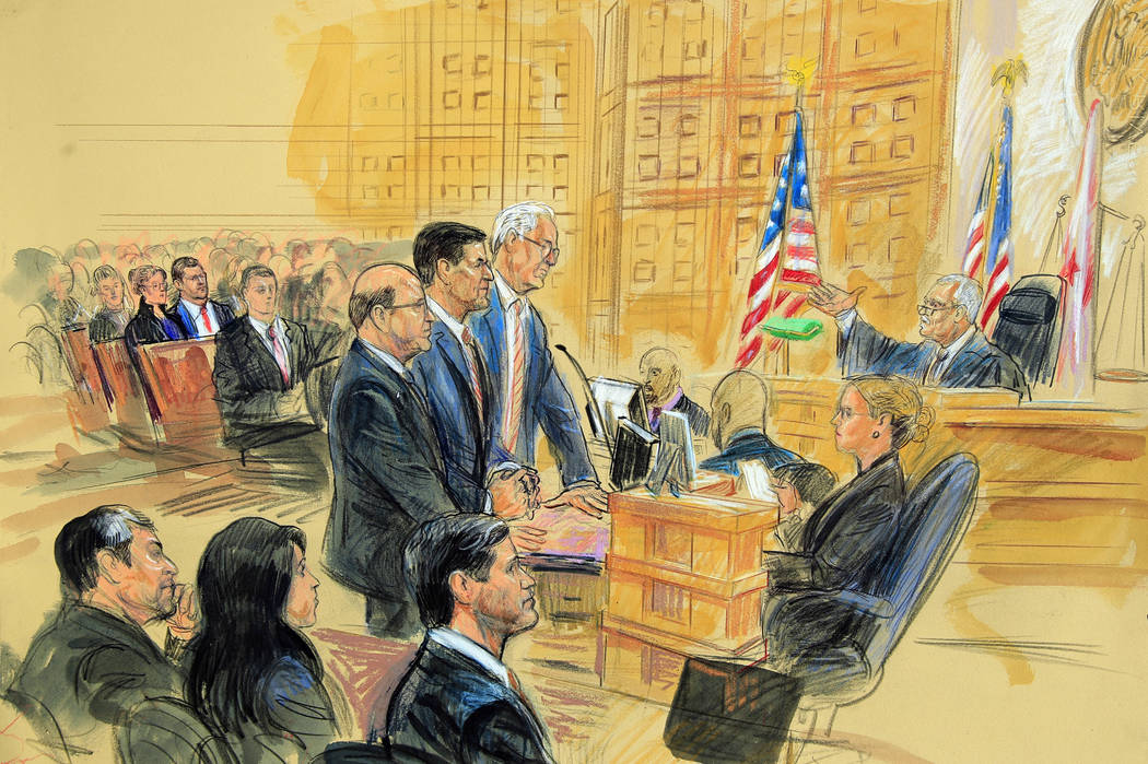 This courtroom sketch depicts former President Donald Trump's former national security adviser Michael Flynn, standing center, flanked by his lawyers, listening to U.S. District Judge Emmet Sulliv ...