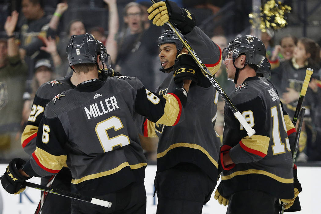 Vegas Golden Knights right wing Ryan Reaves, center, celebrates after scoring against the Los Angeles Kings during the second period of a preseason NHL hockey game Friday, Sept. 28, 2018, in Las V ...