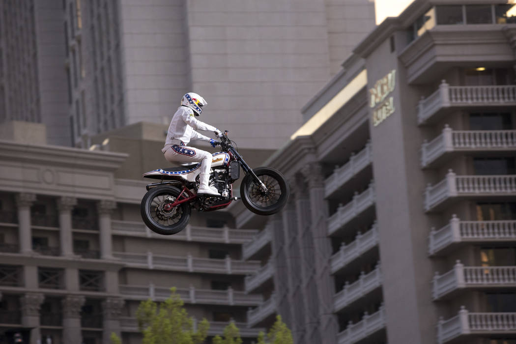 "Travis Pastrana jumps over the fountains at Caesars Palace on an Indian Scout FTR750 motorcycle during ""Evel Live,"" a three-hour live tribute show to stuntman Evel Knievel, in Las Vegas ..."