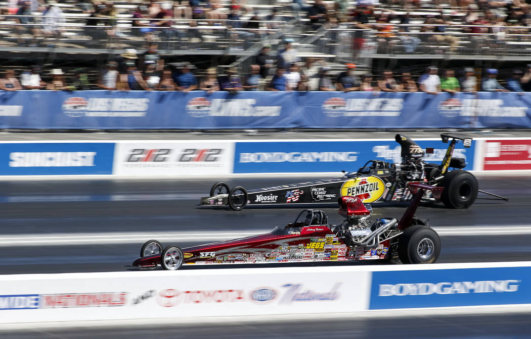 Race cars drivers compete during the first round of final eliminations on the final day of the DENSO Spark Plug NHRA Four-Wide Nationals at The Strip at Las Vegas Motor Speedway in Las Vegas on Su ...