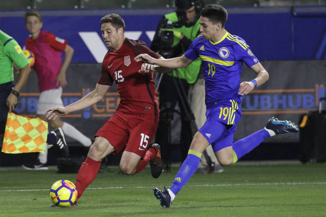 United States defender Matt Polster, left, controls the ball under pressure by Bosnia and Herzegovina forward Luka Menalo during the first half of an international friendly soccer match on Sunday, ...