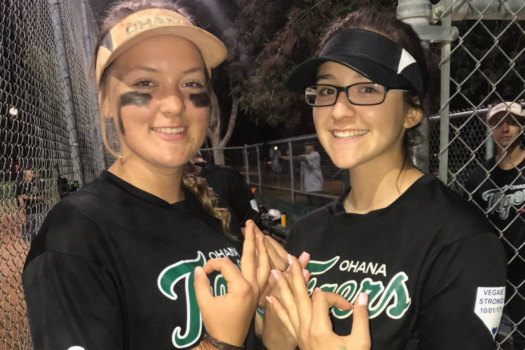 Softball players Jordyn Ebert, left, and Khevyn Arroyo make a No. 3 sign to honor Quinton Robbins of Henderson, who was among those killed in the Route 91 Harvest festival shootings. (Pam McCullough)