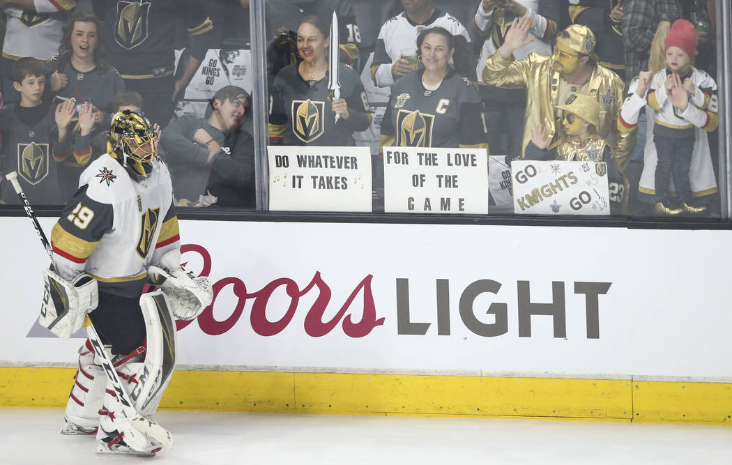 Golden Knights fan Dee Dravnieks of Perth, Australia, center left, with friend Savvy Collins of Las Vegas, cheer on Golden Knights players - including goaltender Marc-Andre Fleury (29) - as they w ...