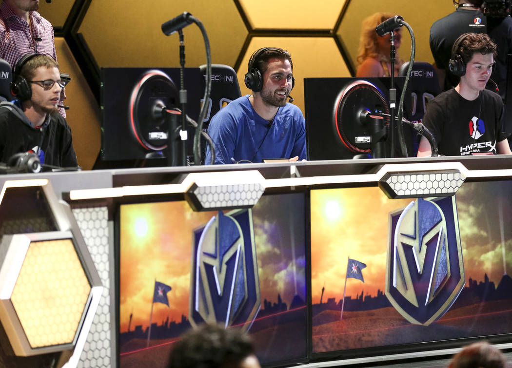 "Vegas Golden Knights right wing Alex Tuch, center, plays ""Fortnite"" with fans at the HyperX Esports Arena inside the Luxor in Las Vegas on Tuesday, Dec. 18, 2018. Richard Brian Las Vegas ..."